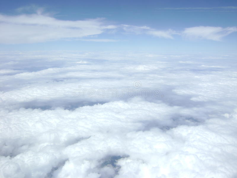 Fluffy bright cloud layer below blue sky royalty free stock photo