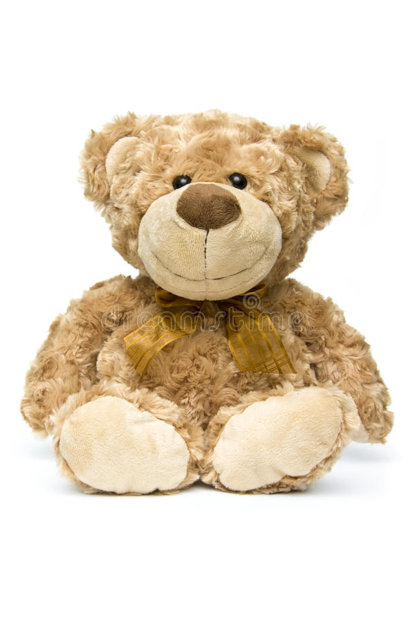 Fluffy brown teddy bear sitting down stock photos
