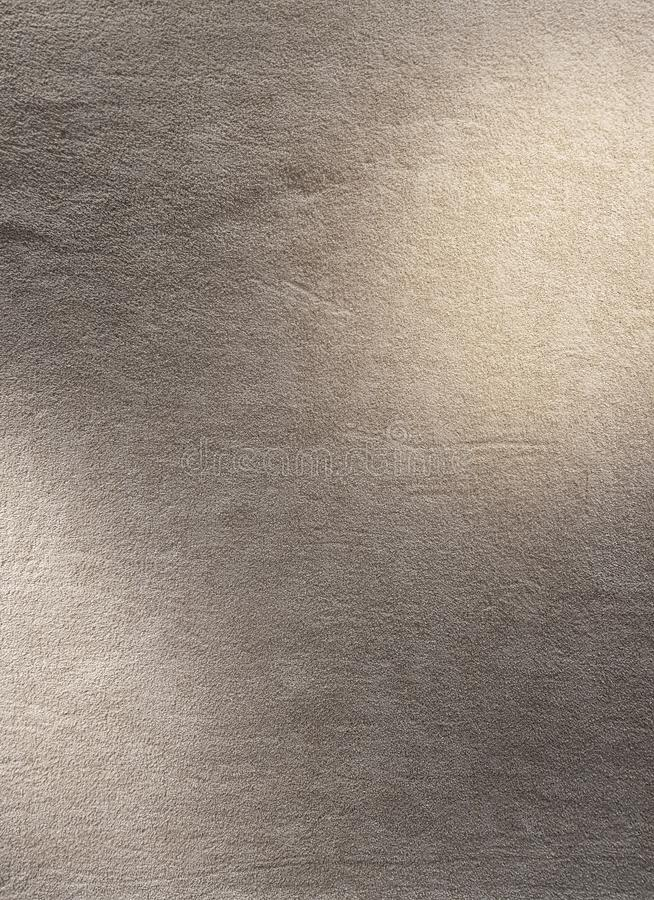 Fluffy carpet texture in gray color with spot light to put graphic / background texture / interior design royalty free stock image