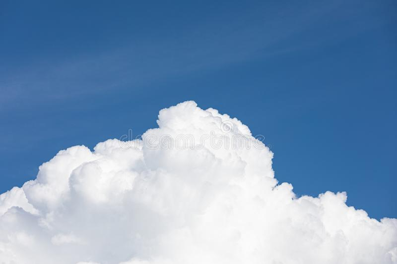 Fluffy cloud edge and blue sky. Cloudscape background stock photos