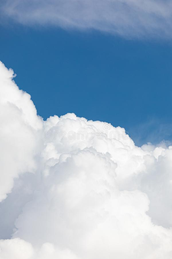Fluffy cloud edge and blue sky. Cloudscape background royalty free stock images