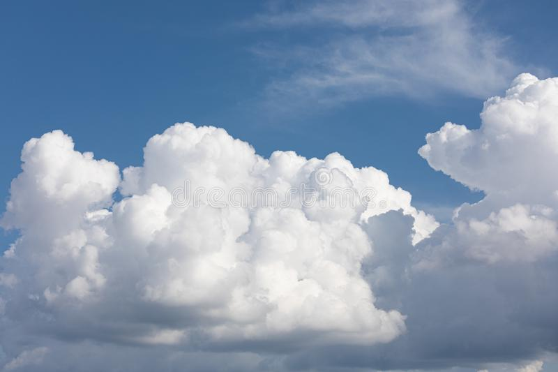 Fluffy cloud edge and blue sky. Cloudscape background royalty free stock photography