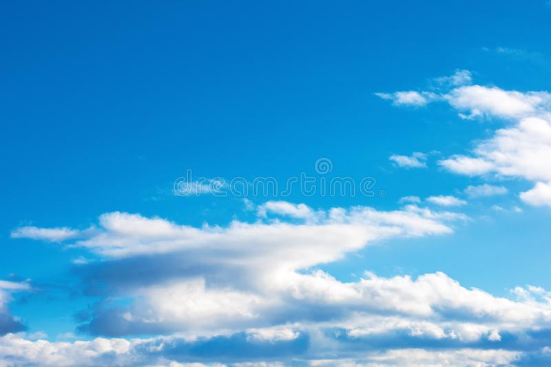 Fluffy clouds on the azure winter sky stock photography