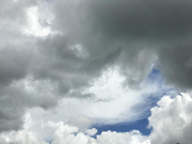Fluffy Clouds Before a Canadian Prairie Rainstorm. Upward view of full fluffy clouds just before a a typical rainstorm in Alberta, Canada stock photography