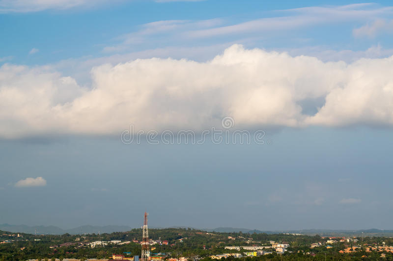 Fluffy clouds over the city in the afternoon stock photo