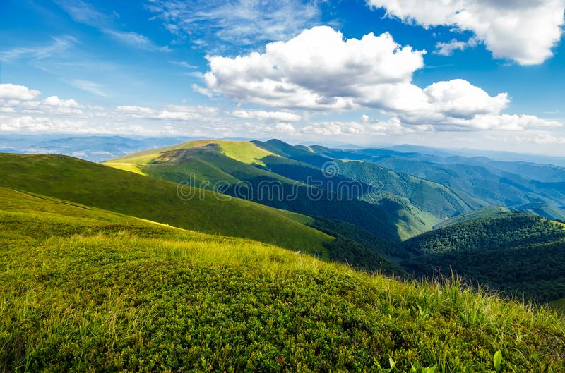 Fluffy clouds over the mountain ridge royalty free stock photos