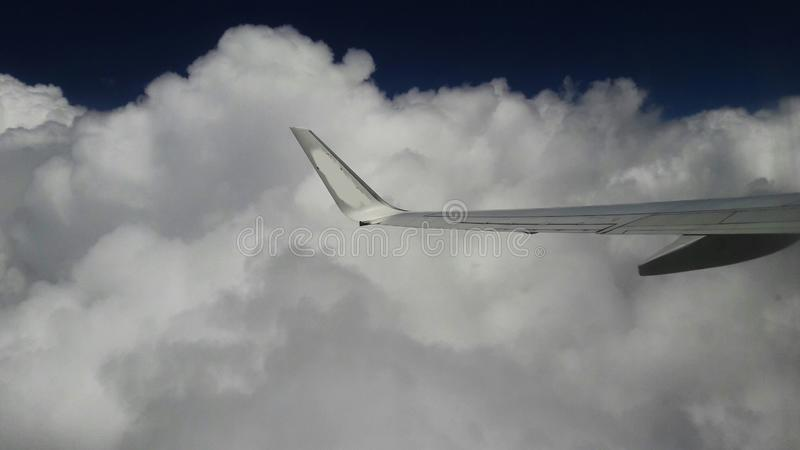 Fluffy clouds  View from airplane window royalty free stock photos