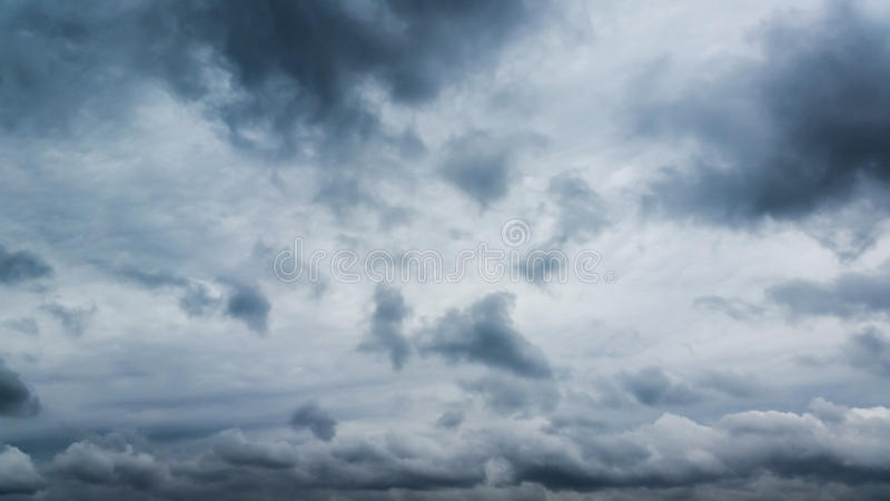 Fluffy gray rain clouds. In the sky stock images
