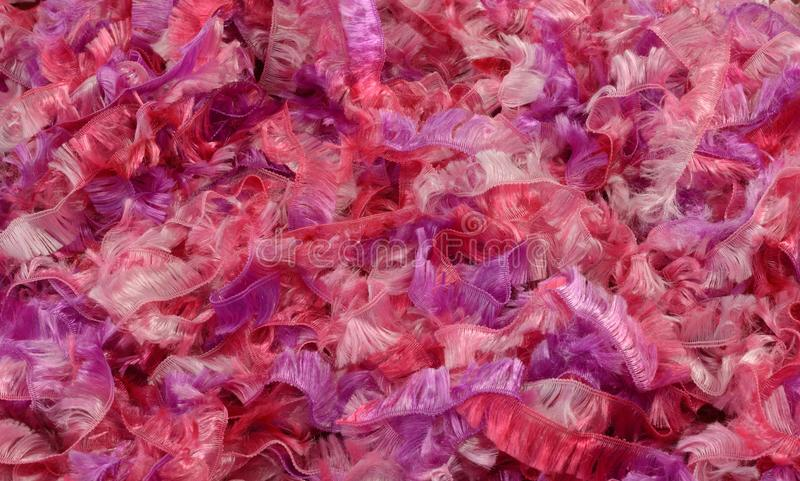 Fluffy pink and purple yarn or ribbon stock photos