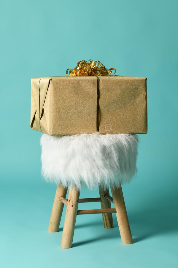Fluffy poof with golden box royalty free stock photography
