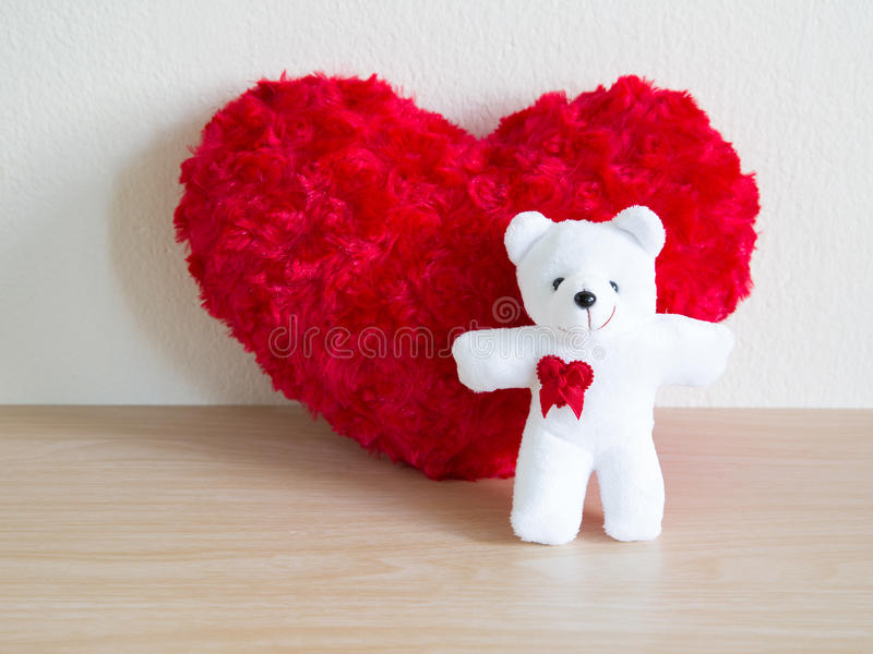 Fluffy red heart and happy white teddy bear for love royalty free stock photos