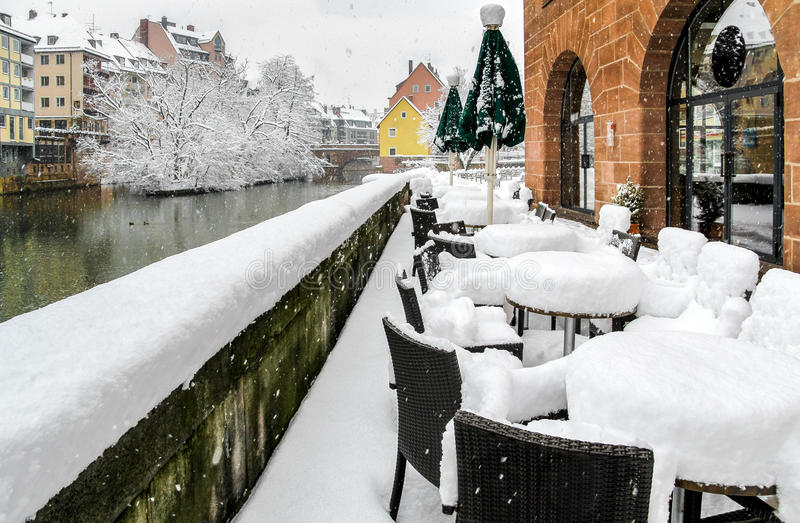 Fluffy snow in Nuremberg, Germany- amazing snowy outdoor cafe royalty free stock images