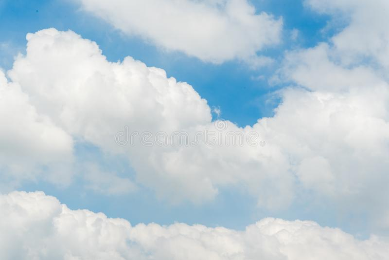 Fluffy blue sky in day light. Fluffy white clouds in blue sky in clear atmosphere rainy days stock images