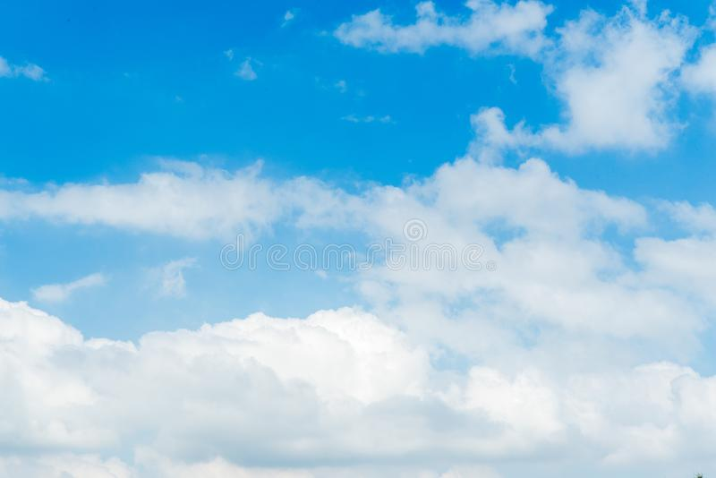 Fluffy blue sky in day light. Fluffy white clouds in blue sky in clear atmosphere rainy days stock photos
