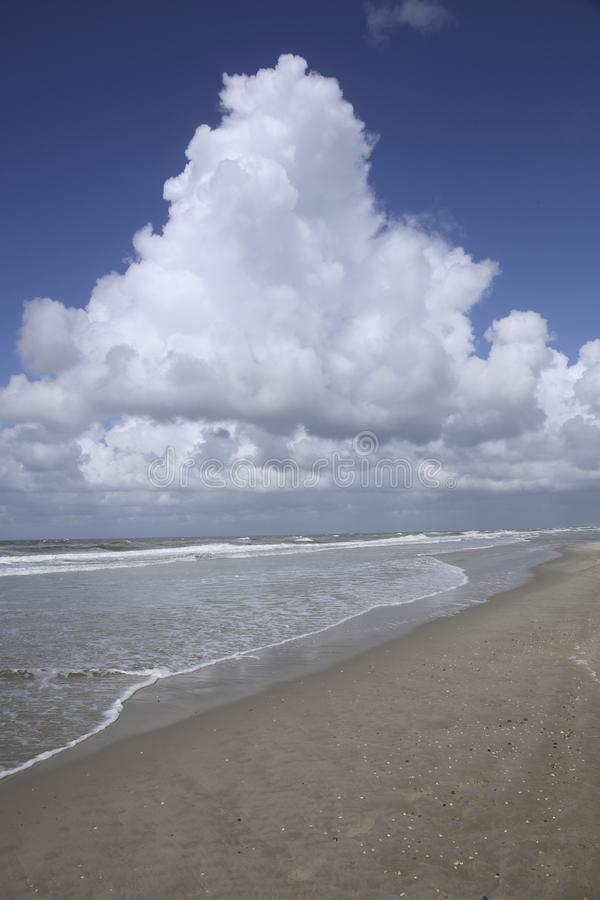 Beach, sea, clouds and a blue sky, The Netherlands stock photos