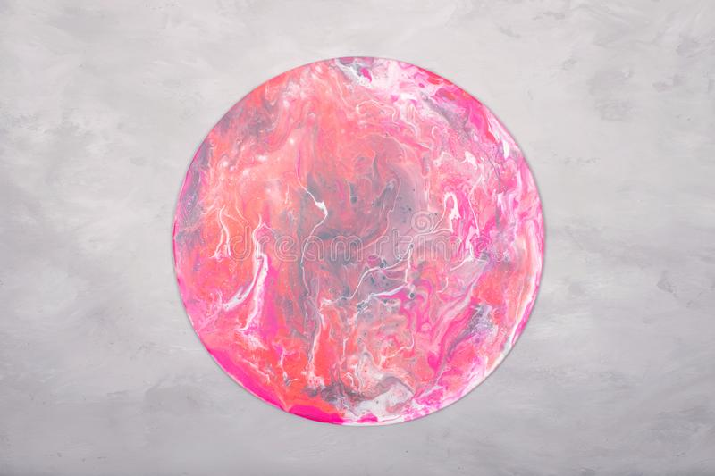 Fluid acrylics art picture. Pouring acrylic paint in pink colors on grey background. Creative artwork stock photos