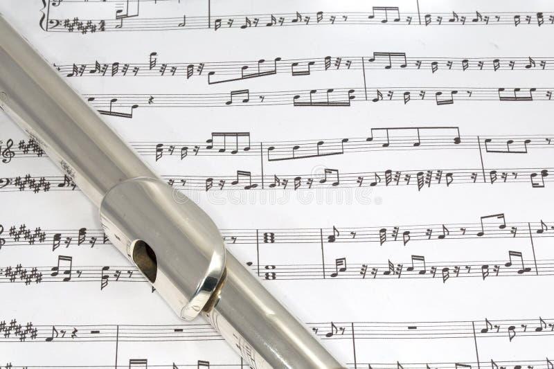 Fluitmondstuk op Bladmuziek royalty-vrije stock afbeelding