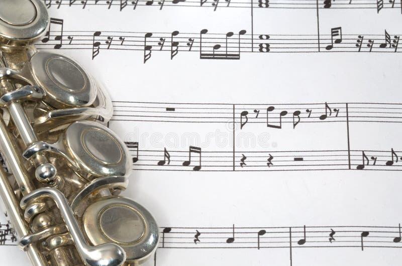 Fluitsleutels op Bladmuziek stock foto