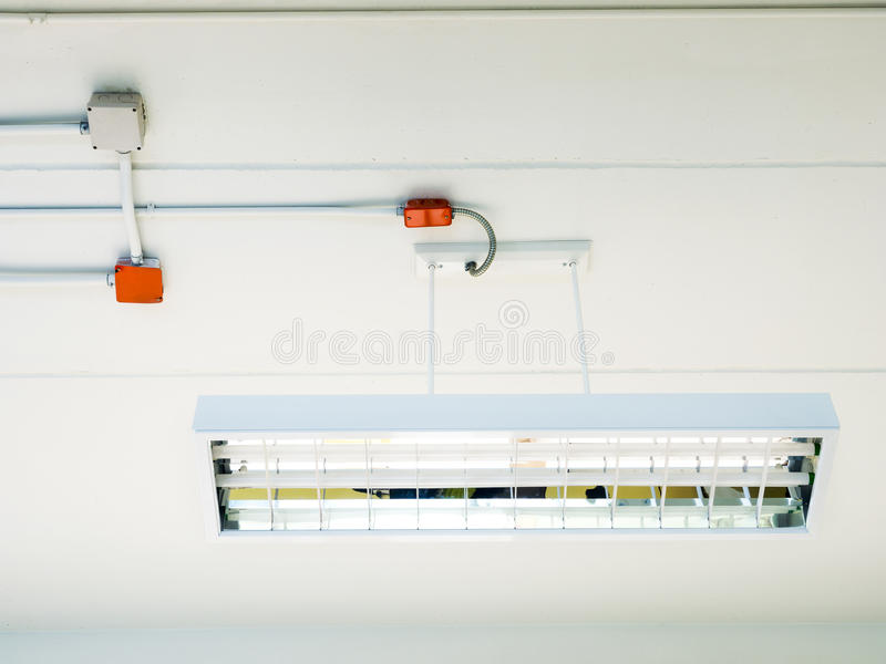 Fluorescence tube installed on ceiling. Fluorescence tube installed on lamp over ceiling room royalty free stock image