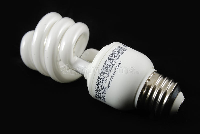 Fluorescent bulb with black background. In closeup shot stock image