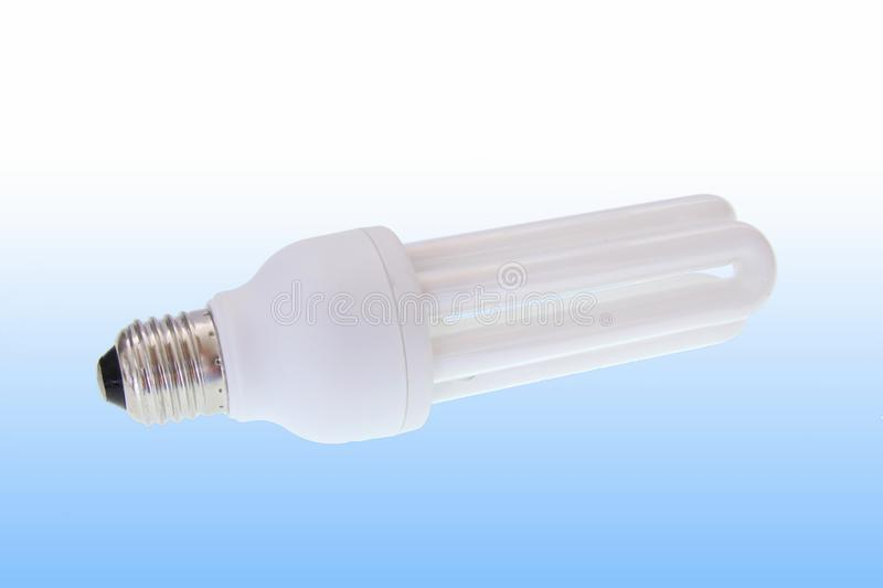 Fluorescent energy saving light bulb. On white stock images