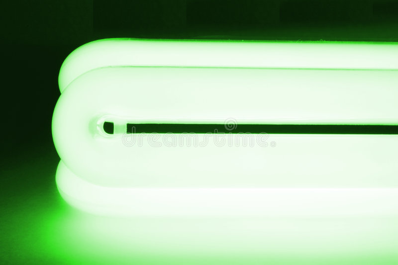 Fluorescent lamp I. Fluorescent lamp with Green background royalty free stock photography