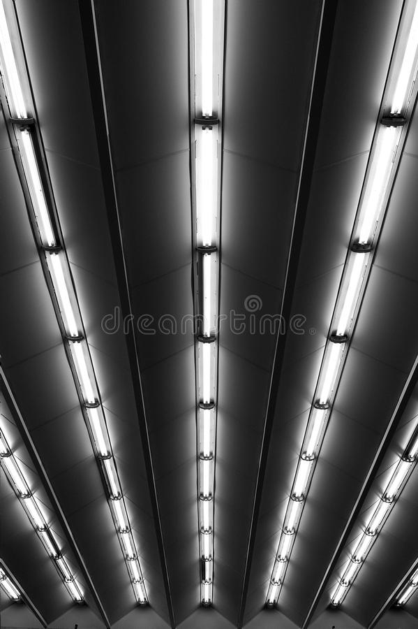 Fluorescent lamps line, metro station ceiling stock photography