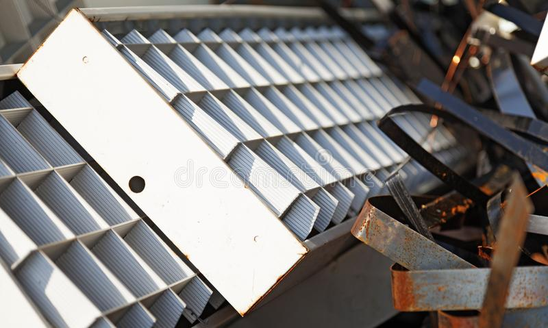 Fluorescent lamps and metal debris royalty free stock images