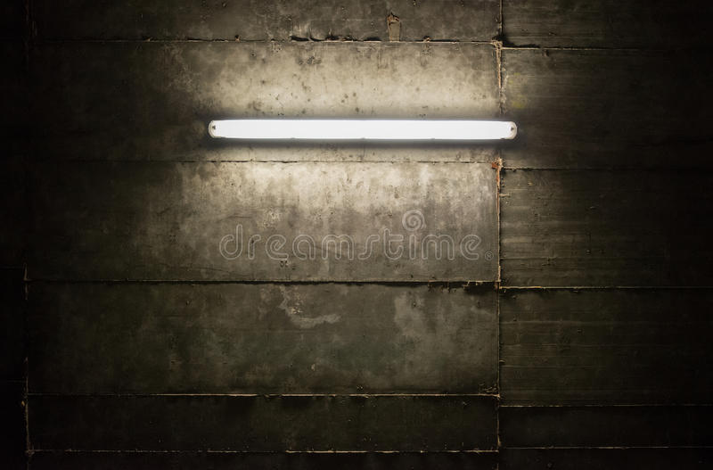 Fluorescent light. Tube on the wall royalty free stock photo