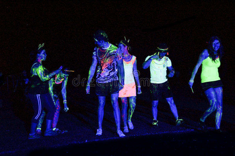 Fluorescent Light Splashed Revelers Of The Glow Run Port