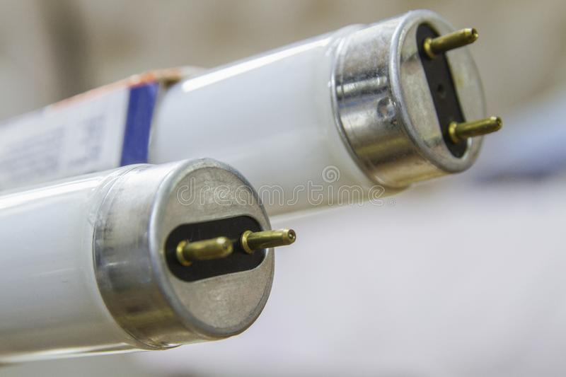 Fluorescent light tubes in a close-up picture. A couple fluorescent light tubes in a close-up picture stock photography