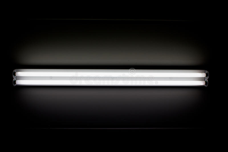 Fluorescent mounted on wall. A fluorescent tube mounted on a wall stock photography