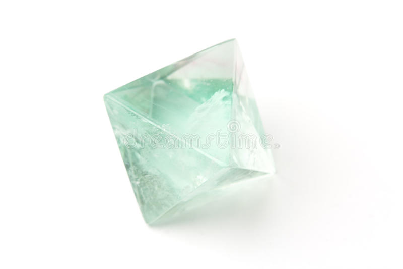Fluorite crystal. Natural raw fluorite crystal isolated on white. Shallow dof stock image