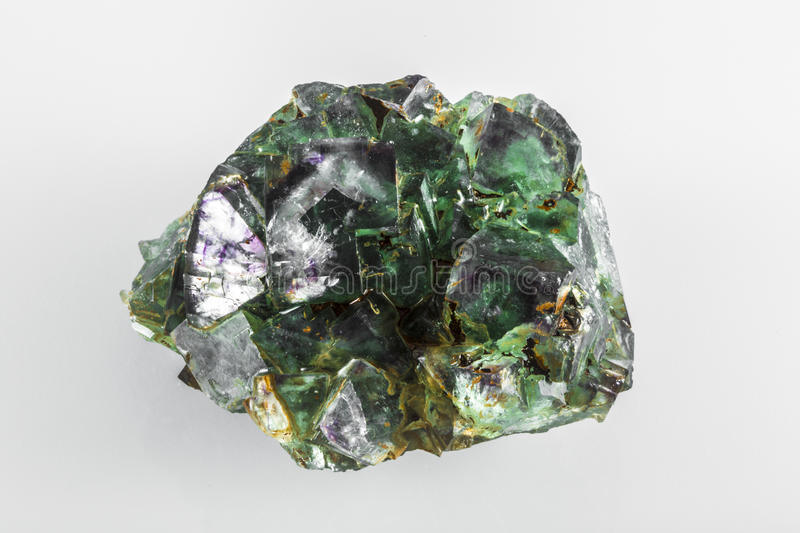Fluorite Mineral Rock. Fluorite is a very popular mineral, and it naturally occurs in all colors of the spectrum. This rock is primarily green and purple stock photo