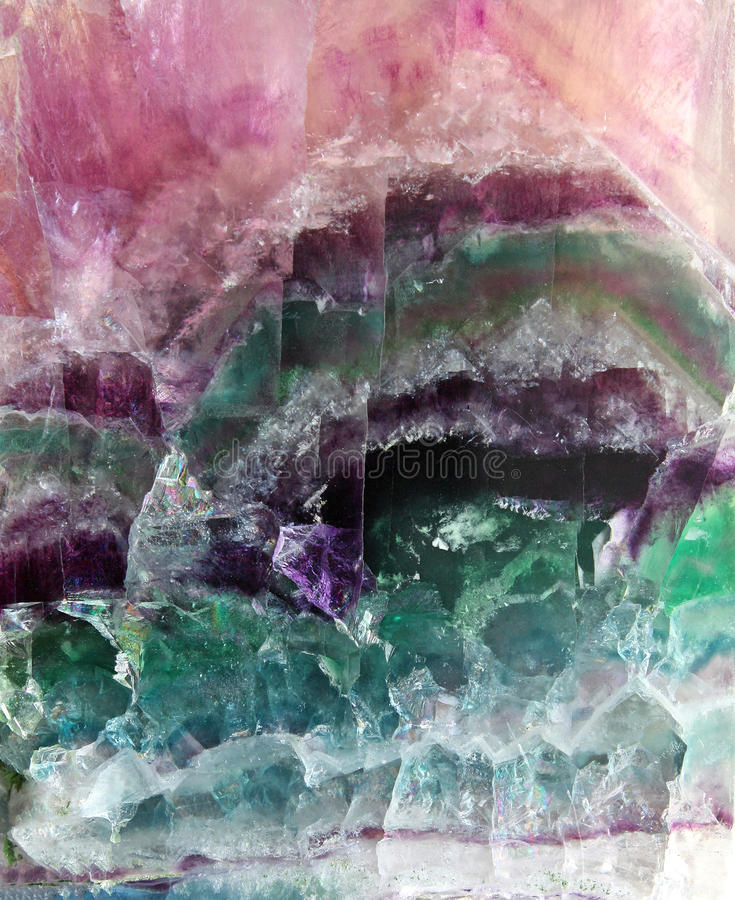 Fluorite pattern. Pattern of a sparkling stone of fluorite poured by different colors stock images