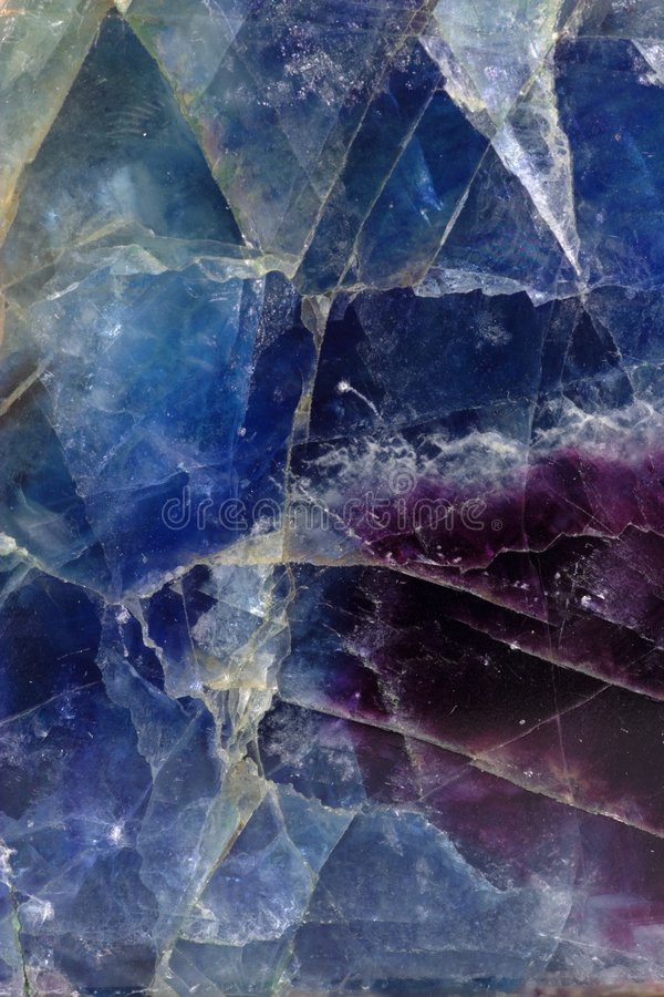 Fluorite pattern. Pattern of blue-violet fluorite mineral royalty free stock photo