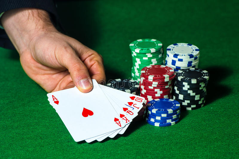 Flush in poker and betting chips royalty free stock image