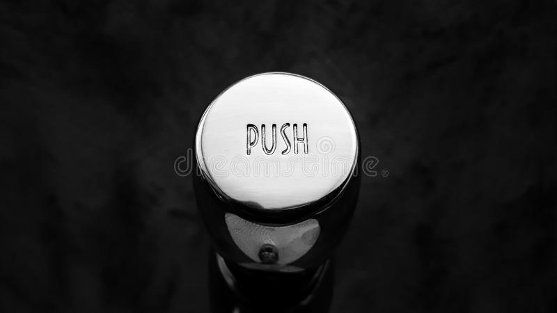Flushing button of sanitary ware. stock photography