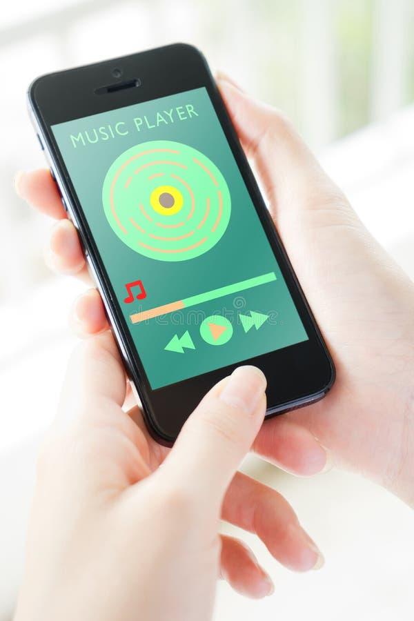 Flusso continuo dell'applicazione di musica sullo Smart Phone fotografia stock libera da diritti