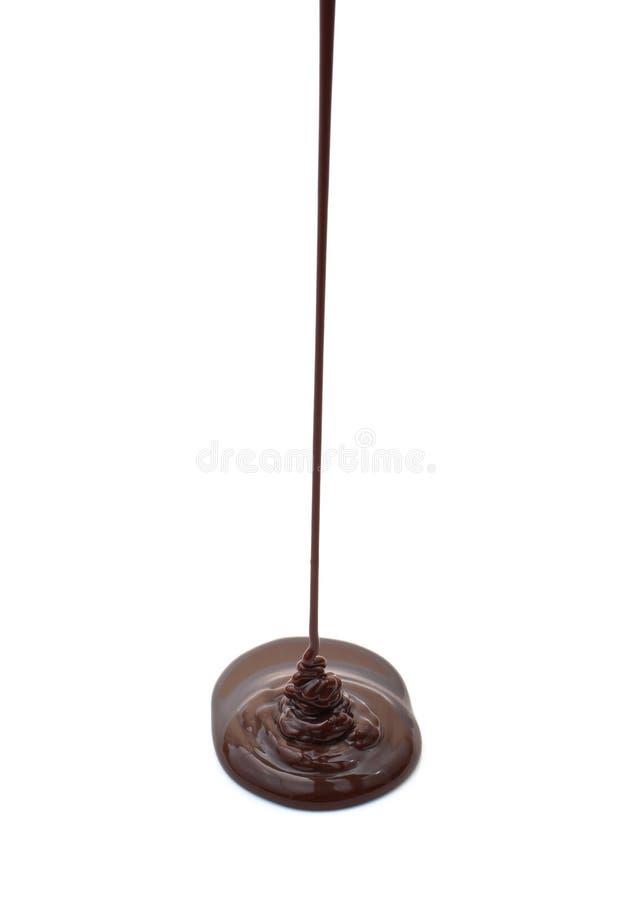Flusso del cioccolato caldo isolato fotografie stock libere da diritti