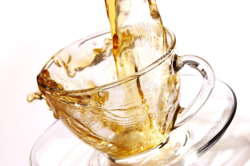 Flusso dorato di tè fotografie stock libere da diritti