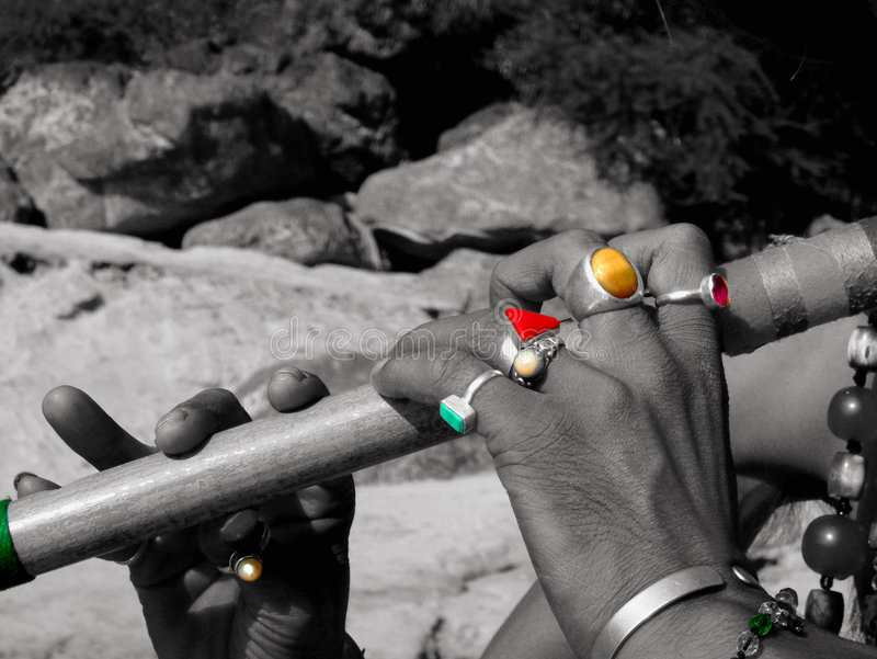 Flute and coloured rings royalty free stock images