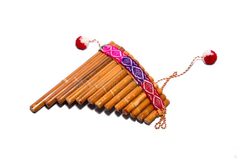 Flute - folk instrument from Peru and Bolivia. Close-up. Isolated on white background. Flute - folk instrument from Peru and Bolivia stock photo