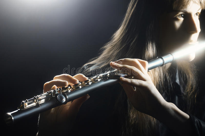 Flute instrument orchestra player royalty free stock images