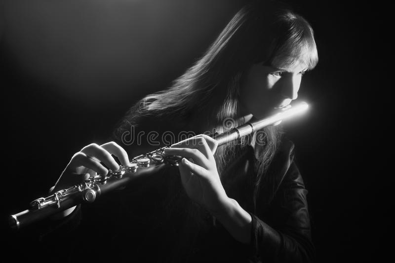 Flute music flutist musician classical playing. stock photos