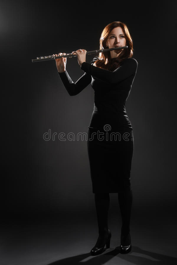 Flute music performer woman flutist royalty free stock photo