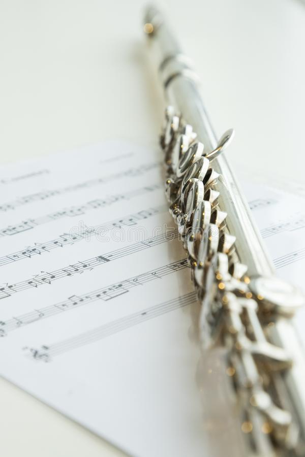 Flute and musical notes, music instrument. stock photography