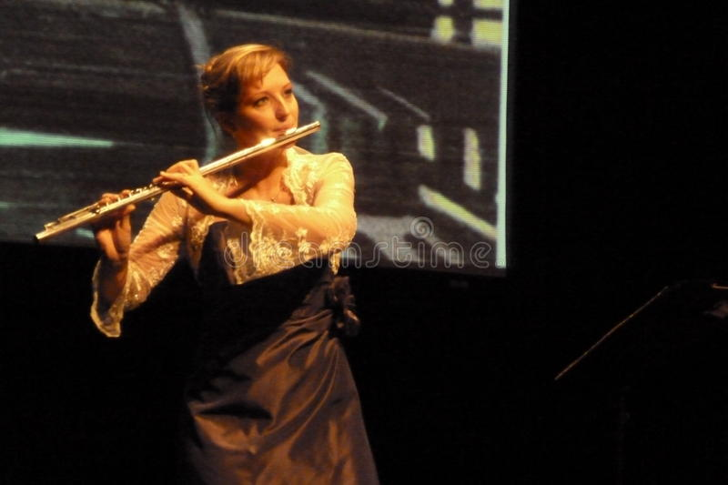 Flute Musician Emma Minchin on Boldtaks stage stock photography