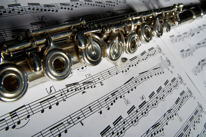 Flute and notes royalty free stock image