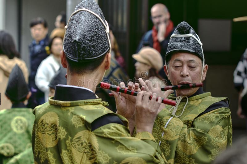 Flute players. Japanese flute players play together at Takayama festival - matsuri - where local people in traditional costumes marching the streets of historic